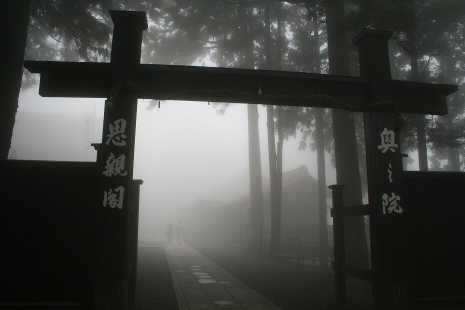 "The mysterious, spiritual atmosphere surrounding Buddhist buildings. The gate says ""Shishinkaku"", which means ""a hall to care for parents"". Devotion to parents is one of the main teaching principles of Nichiren."