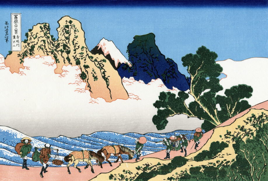 Travelers walking along the Minobu-michi (road) , where you can see Mt. Fuji between the mountains. Painted by a famous ukiyo-e artist, Katsushika Hokusai.
